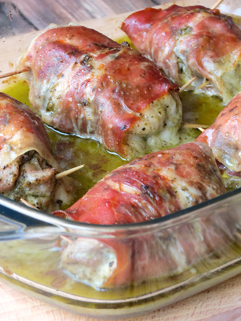 Prosciutto Wrapped Mozzarella Stuffed Chicken Thighs | YummyAddiction.com