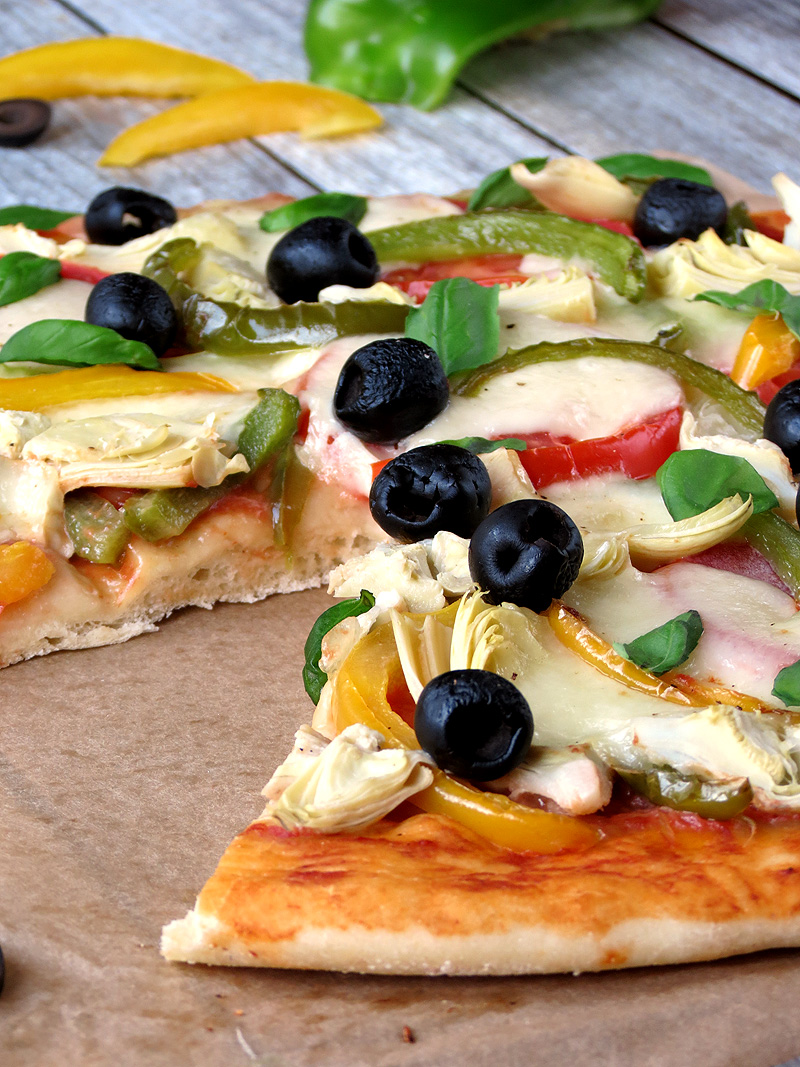Veggie Pizza - topped with artichokes, tomatoes, bell peppers, olives, basil and mozzarella cheese | YummyAddiction.com