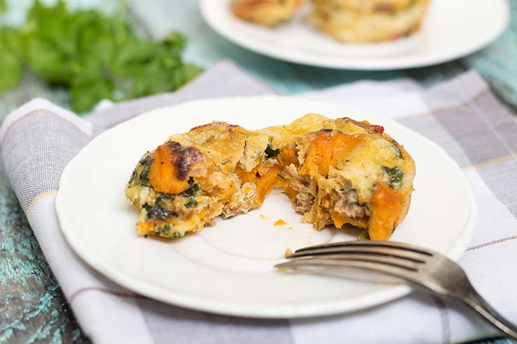 These individual sized frittata muffins are filled with sweet potatoes, spinach and prosciutto. Perfect for breakfast! | yummyaddiction.com