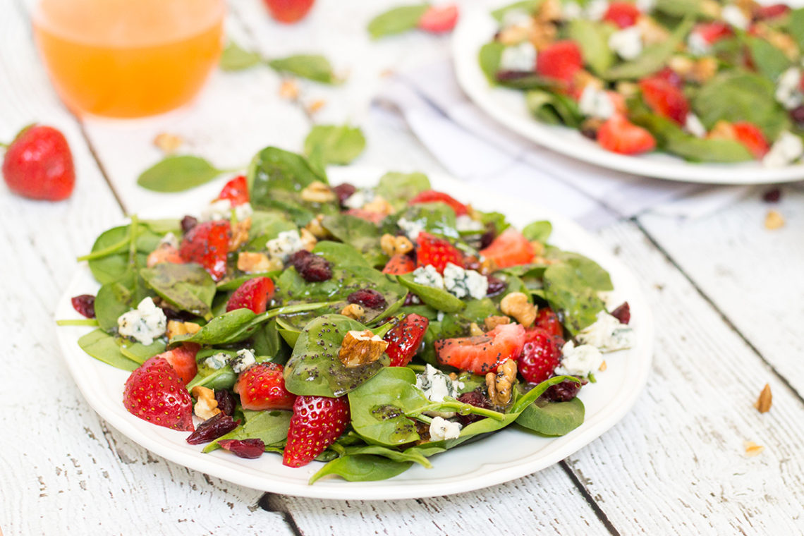 This Strawberry Walnut Salad features spinach, blue cheese, cranberries, and is topped with a fantastic poppy seed dressing. Perfect for summer! | yummyaddiction.com