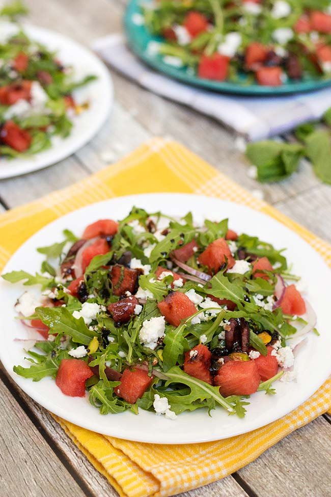 This Arugula Watermelon salad also features feta cheese, mint, pistachios, and olives! Perfect for summer! | yummyaddiction.com