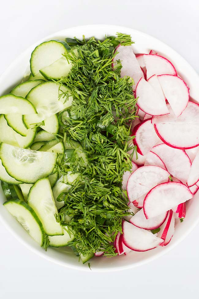 This Radish Cucumber Dill Salad with sour cream is crunchy and refreshing. It marks the start of summer! | yummyaddiction.com