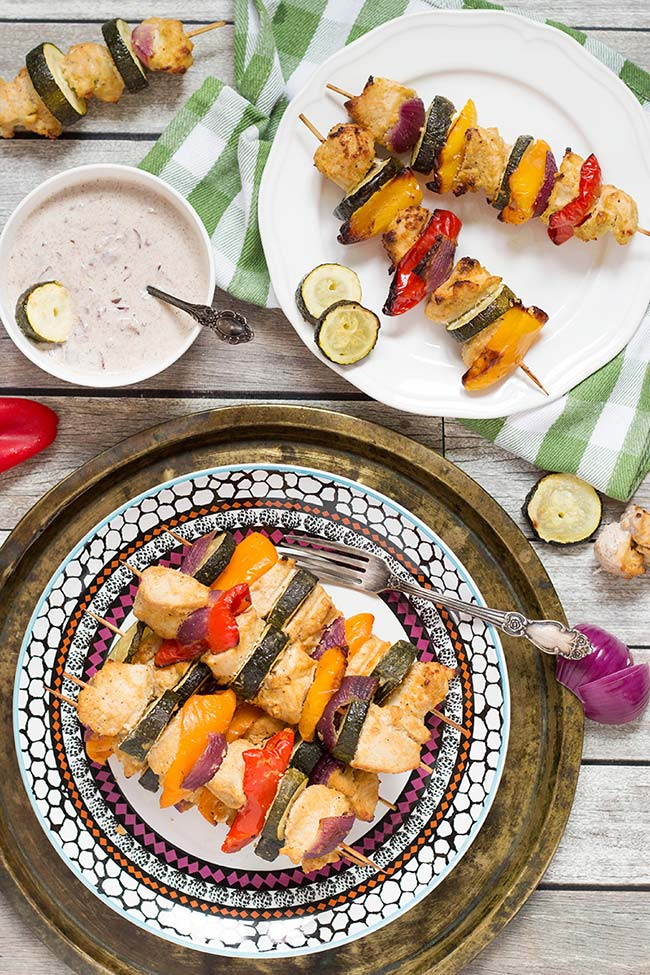 These Chicken Shish Kabobs are marinated in Middle Eastern spices and are served along with the amazing Yogurt and Red Onion Dip! | yummyaddiction.com
