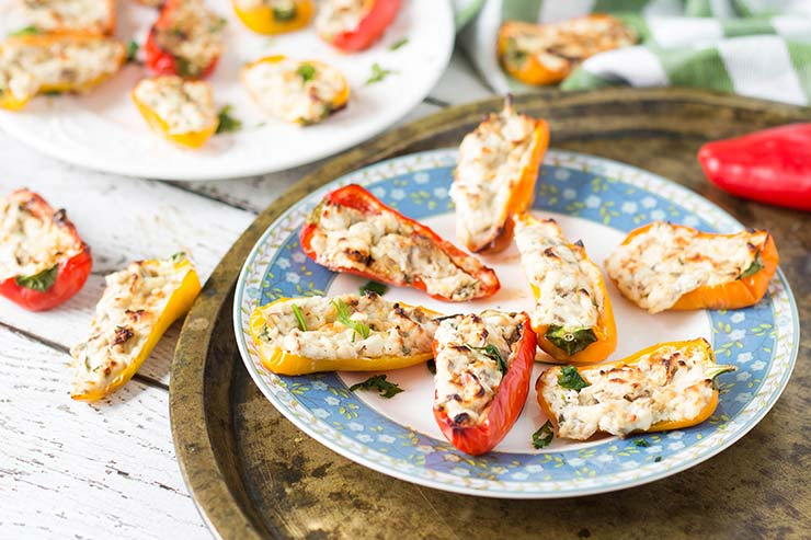 These delicious and colorful Mini Cream Cheese Stuffed Peppers are also packed with mushrooms, walnuts and other goodies. The perfect appetizer! | yummyaddiction.com