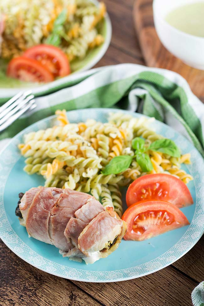 These Bacon Wrapped Chicken Breasts are stuffed with prunes and served with a simple and delicious chicken gravy. Quick and easy to make - a perfect weeknight dinner! | yummyaddiction.com