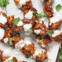 Peanut Butter Chicken is a perfect choice when you need some variety. Weaved onto skewers and served alongside a yogurt-dill sauce, it makes for a fantastic dinner! | yummyaddiction.com