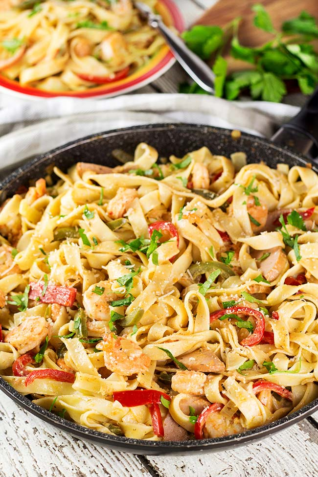 This creamy Cajun Shrimp and Sausage Pasta makes a perfect weeknight dinner. It's quick & easy to make + it's one-pot! Oh and the taste is fabulous! | yummyaddiction.com