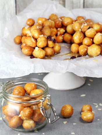 These Italian Honey Balls (Struffoli) are usually served on Christmas and other holidays. They are crunchy on the outside, soft and warm inside. Perfection! | yummyaddiction.com