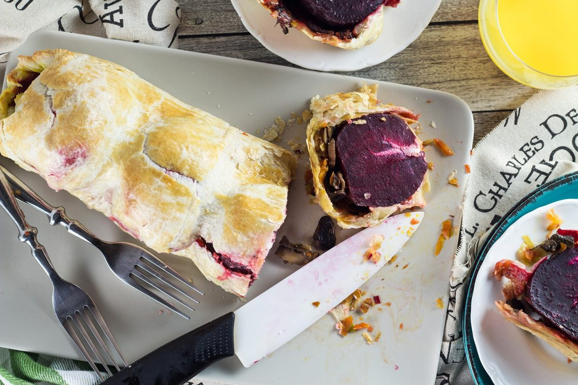 This Vegetable Wellington is a vegetarian variation of the classic dish. It is packed with goat cheese stuffed whole beets, carrots, leek, and mushrooms! | yummyaddiction.com