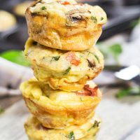 Check out these heavenly delicious Muffin Tin Omelets. They are packed with prosciutto, feta, spinach, and mushrooms. A perfect make-ahead breakfast! | yummyaddiction.com