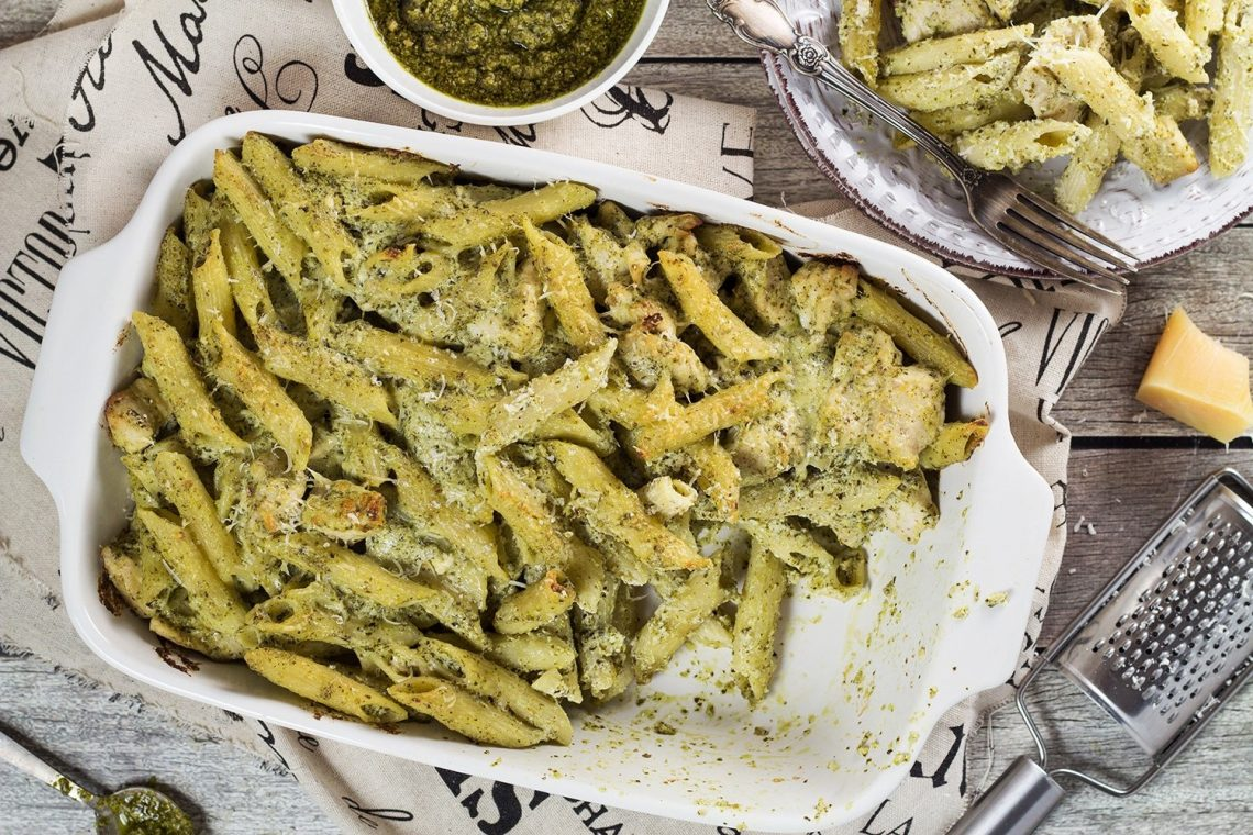 Looking for a perfect weeknight dinner? This Basil Pesto Chicken Pasta Bake is exactly what you need. Easy and quick to make + crazy delicious!   yummyaddiction.com