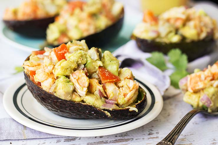 These Chili-Lime Shrimp Stuffed Avocado Shells make a perfect summer meal. Fresh, filling, and full of flavor, they can be eaten as an appetizer, lunch, or a light dinner! | yummyaddiction.com