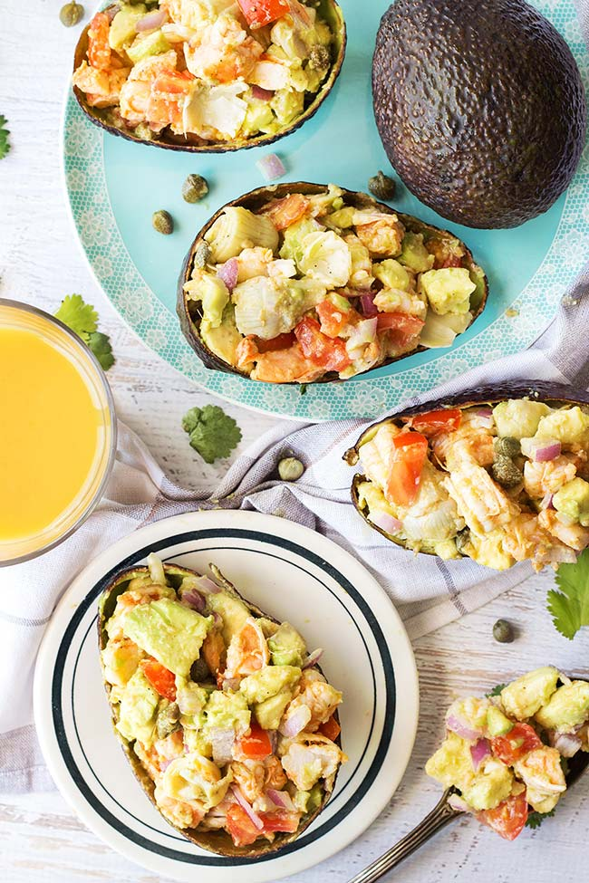 These Chili-Lime Shrimp Stuffed Avocado Shells make a perfect summer meal. Fresh, filling, and full of flavor, they can be eaten as an appetizer, lunch, or a light dinner!   yummyaddiction.com