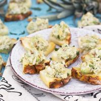 Have you ever tried serving Avocado Chicken Salad on Pineapple Slices? A great appetizer for any occasion your friends and family will absolutely love!   yummyaddiction.com
