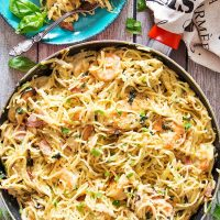 This Chicken and Shrimp Carbonara is an example of a perfect pasta dish. Creamy, rich, comforting, and super delicious, it is guaranteed to become a hit in your house! | yummyaddiction.com
