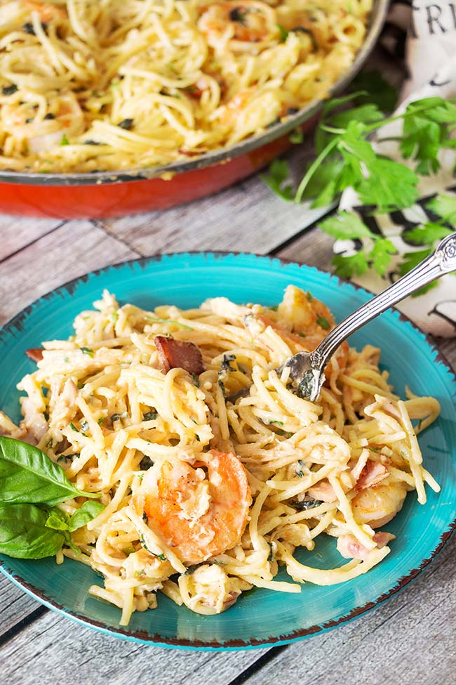 This Chicken and Shrimp Carbonara is an example of a perfect pasta dish. Creamy, rich, comforting, and super delicious, it is guaranteed to become a hit in your house!   yummyaddiction.com
