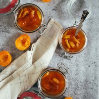 This homemade Apricot Jam is infused with cinnamon and also features candied orange peel! Great on toasts, with cheese, or anywhere you can think of! | yummyaddiction.com