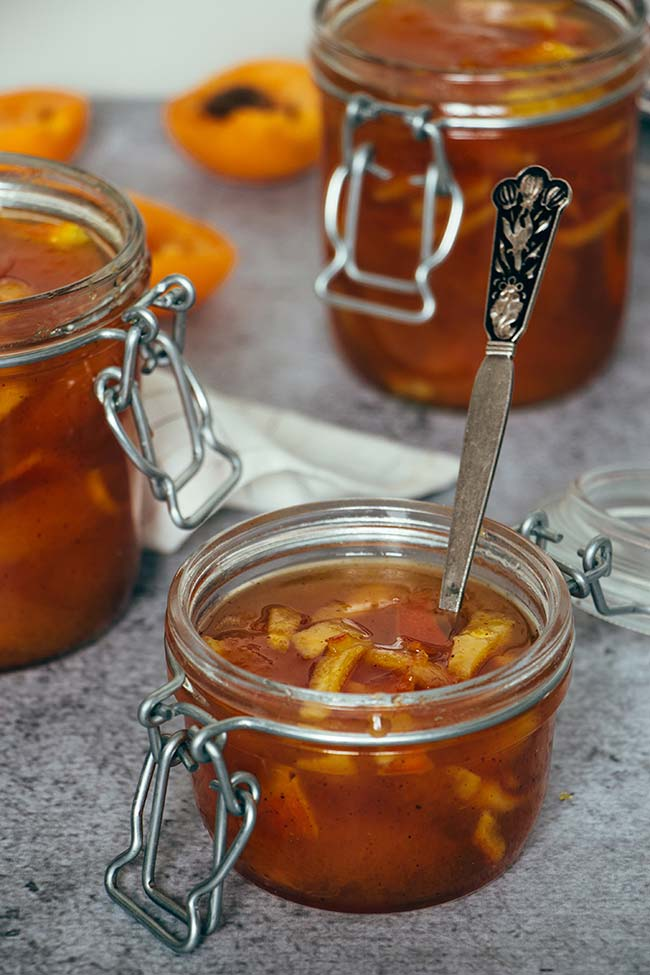 This homemade Apricot Jam is infused with cinnamon and also features candied orange peel! Great on toasts, with cheese, or anywhere you can think of!   yummyaddiction.com