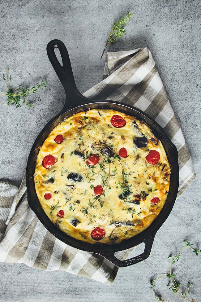 This Eggplant Breakfast Frittata also features tomatoes, potato, and cheddar cheese. A perfect weekend breakfast to pump your body with energy for the day!   yummyaddiction.com