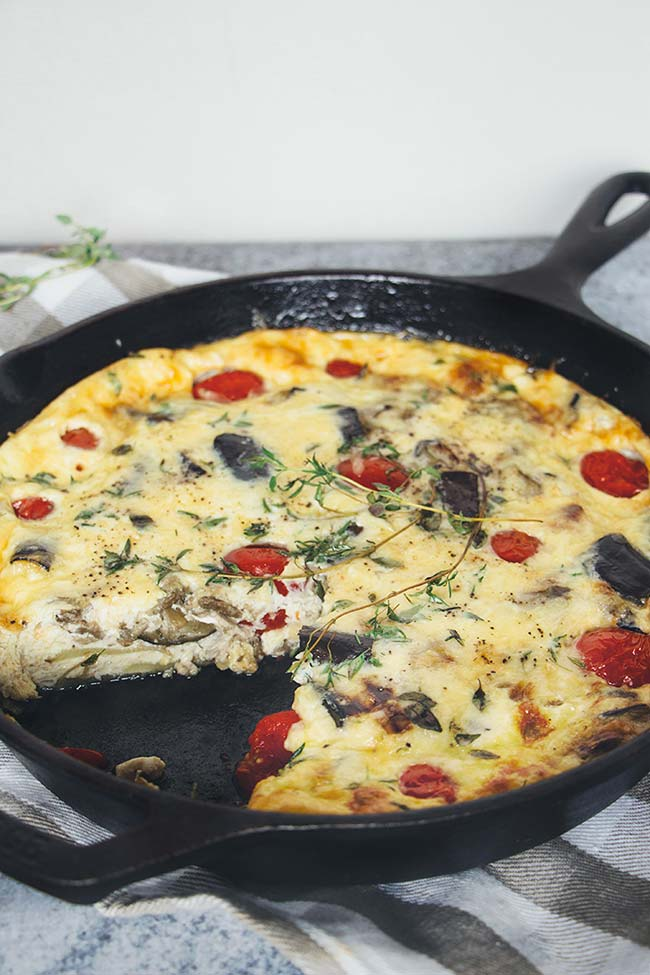 This Eggplant Breakfast Frittata also features tomatoes, potato, and cheddar cheese. A perfect weekend breakfast to pump your body with energy for the day! | yummyaddiction.com