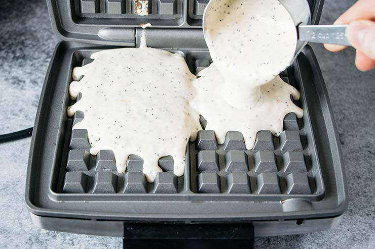 Pouring batter into a waffle iron