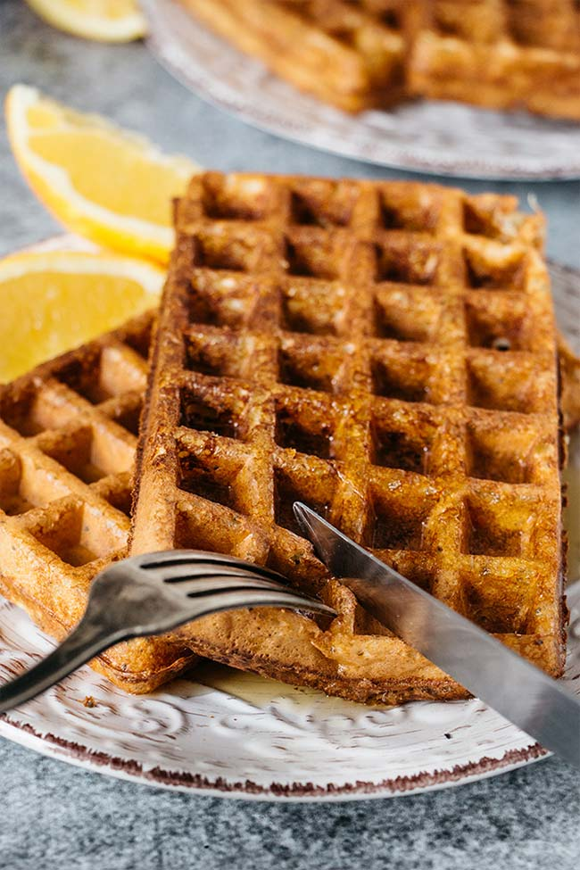 Orange flavored cottage cheese packed waffles drizzled with honey