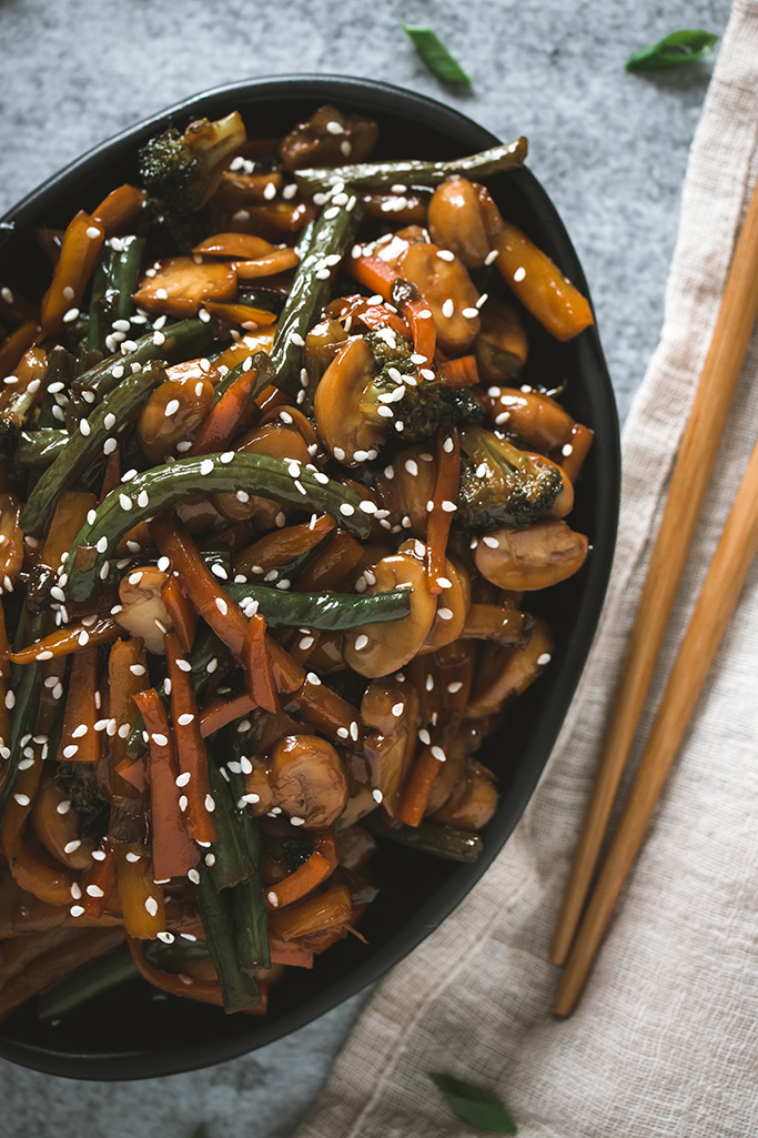 Asian veggie stir fry made with seasonal produce coated in soy sauce ginger mixture