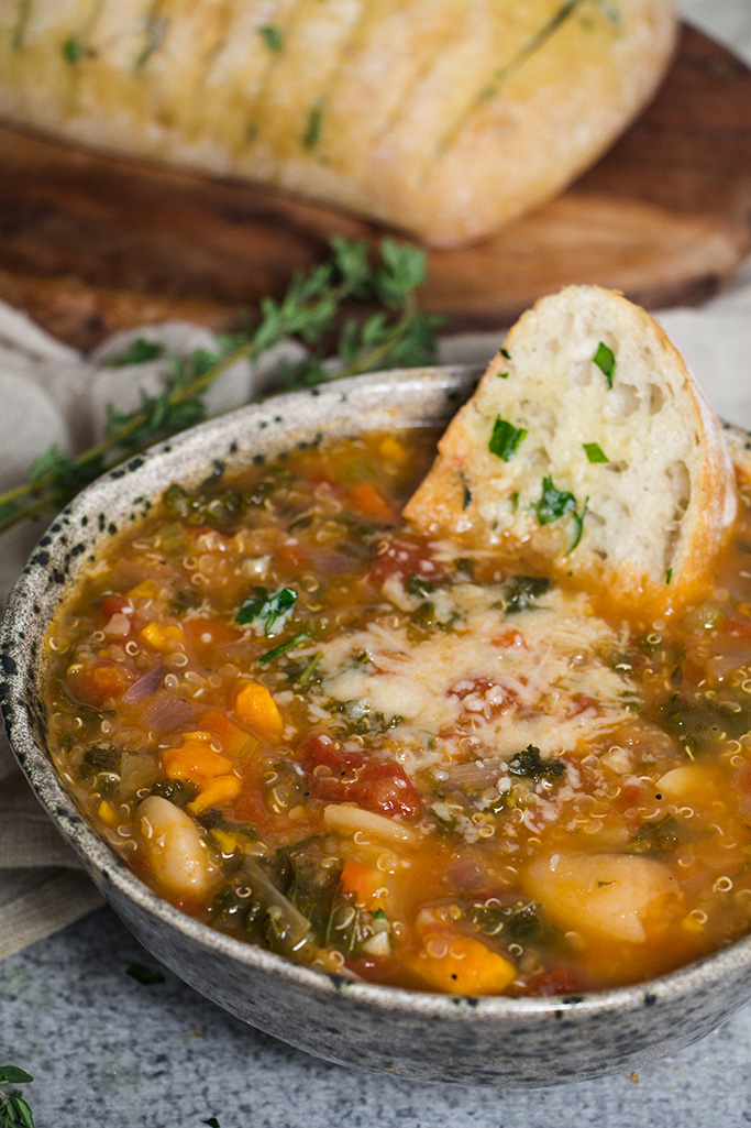 Italian Minestrone made with seasonal winter time vegetables and served with garlic bread