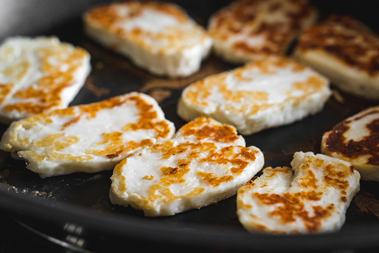 Frying halloumi slices in a pan