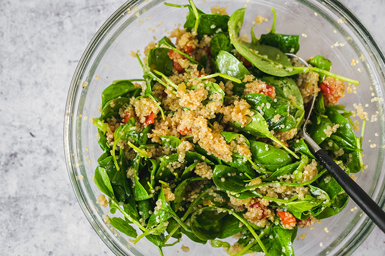 Quinoa, spinach, and fried bell pepper mixed with fig mustard dressing