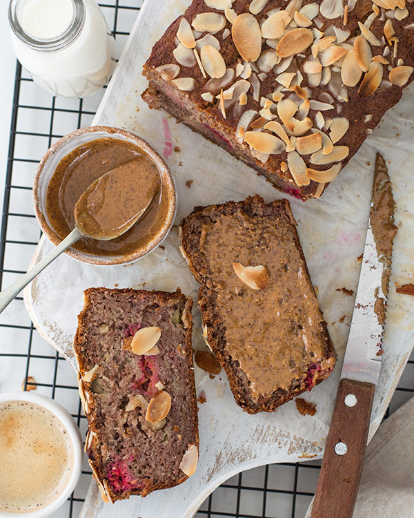 Banana and raspberry bread slices slathered with nut butter