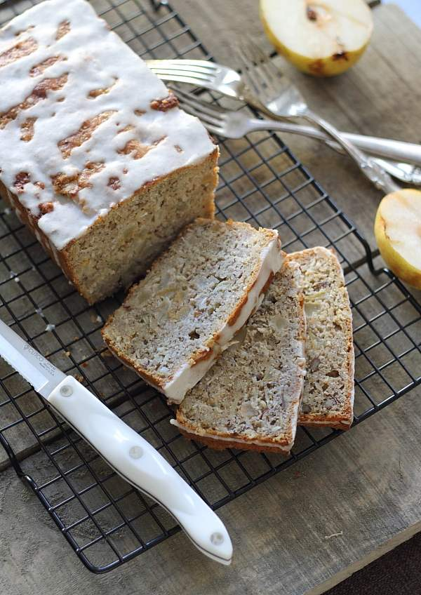 Sliced granola pear bread on a cooling rack