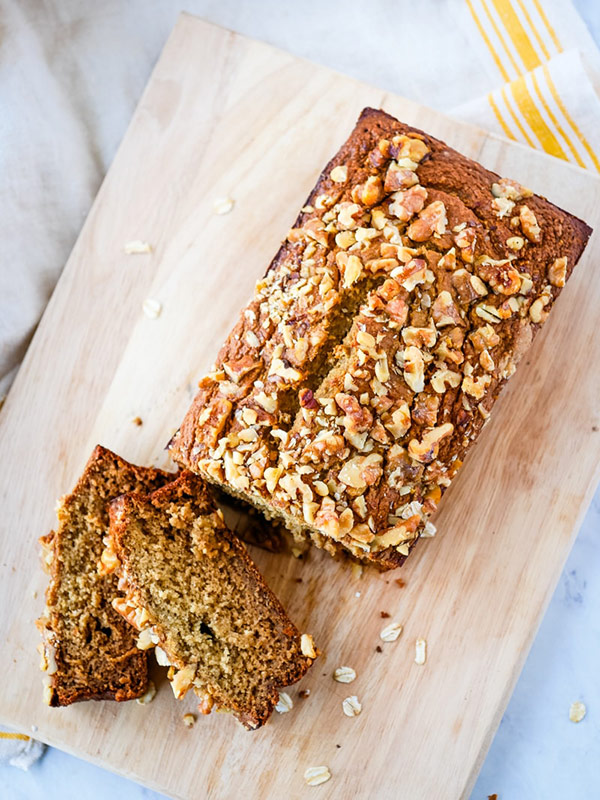 Banana bread with oats on a cutting board