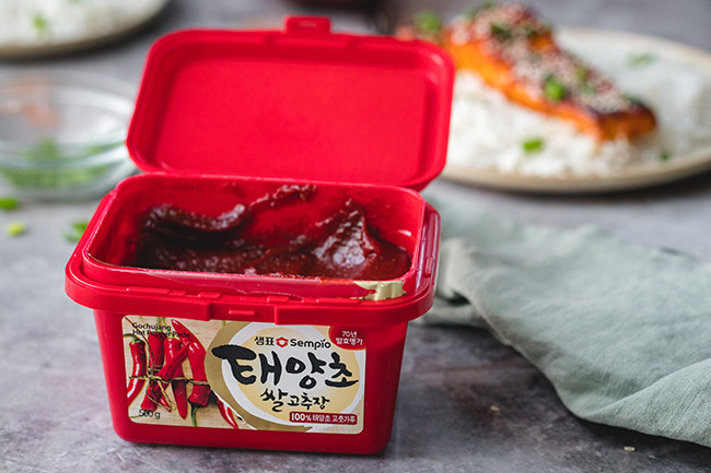 A large container of gochujang paste
