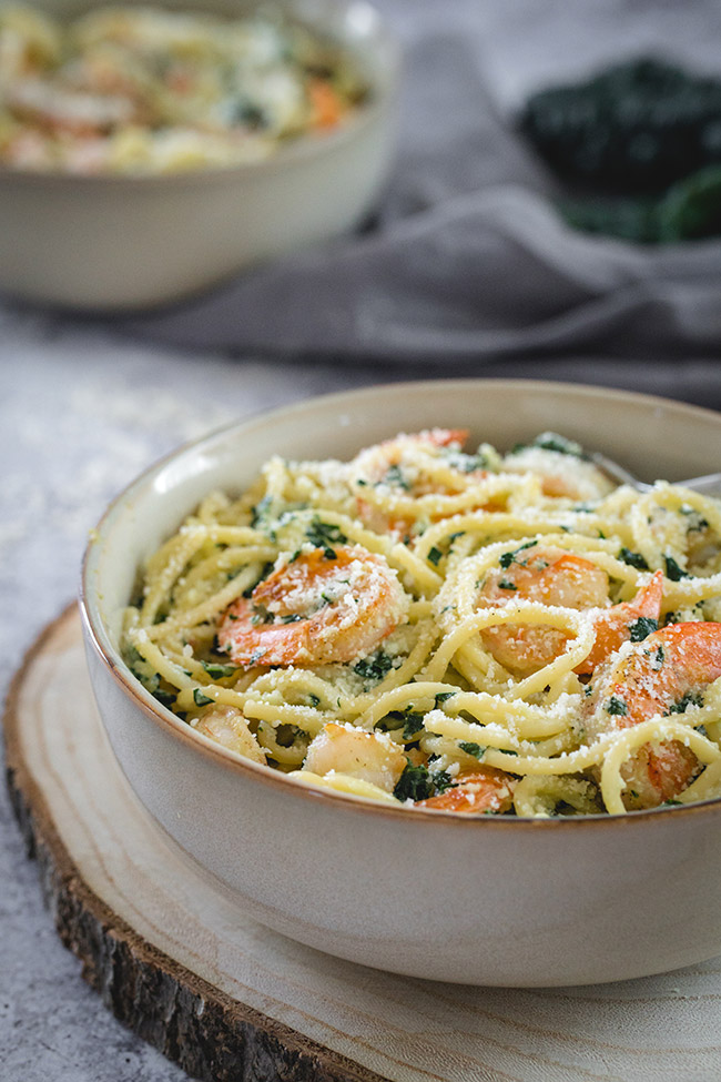 Pasta with shrimp and kale served in a bowl