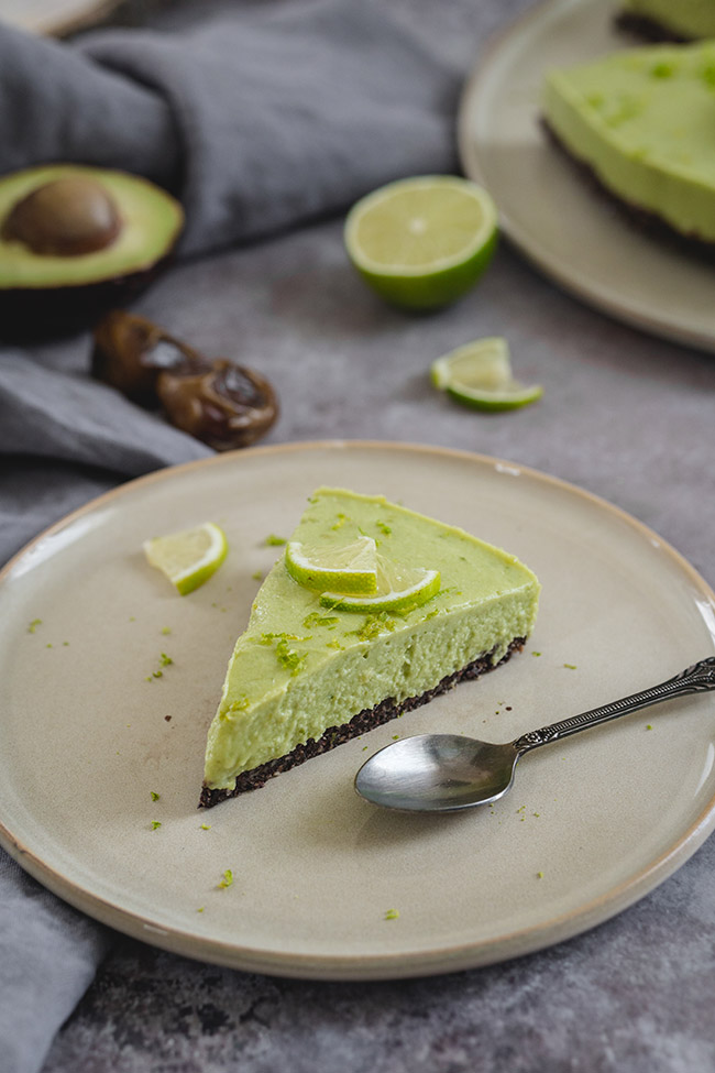 A slice of no-bake avocado lime cheesecake on a plate