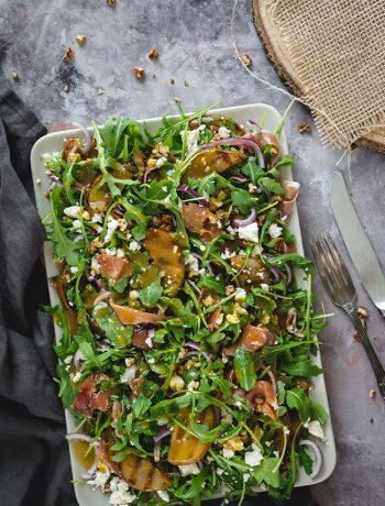 overhead of arugula pear salad