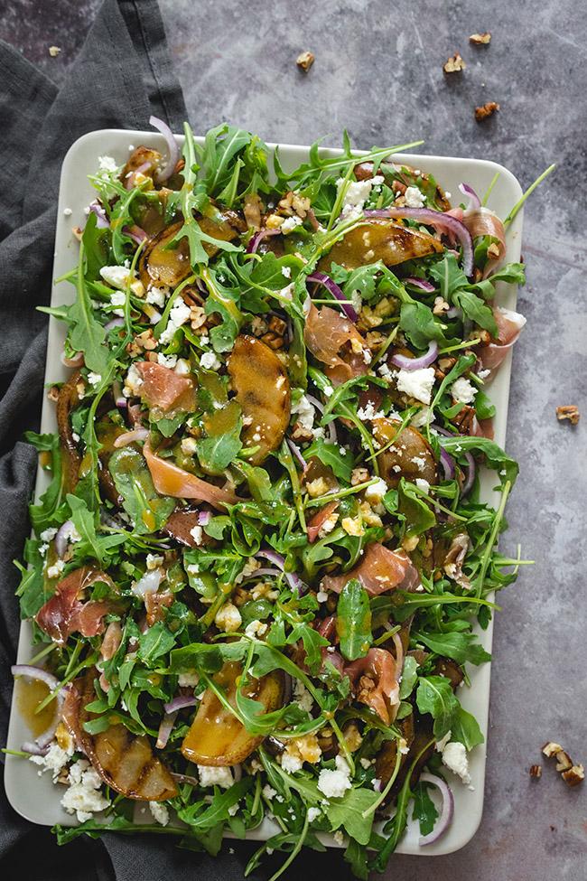 Overhead of arugula prosciutto salad