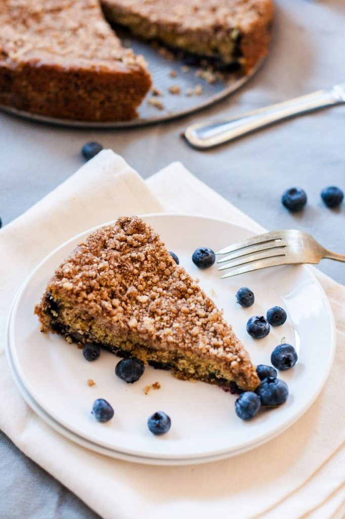 A slice of a healthy cinnamon blueberry coffee cake