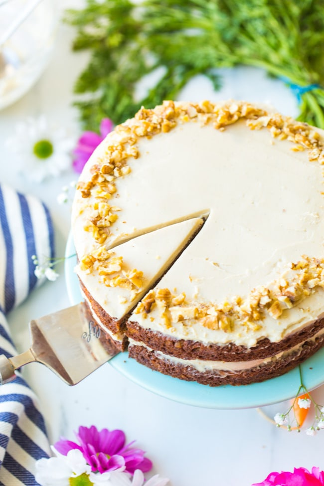 Carrot cake with a cashew cream frosting on a platter