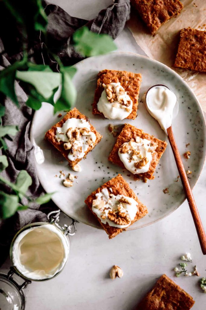 Carrot cake bars topped with cashew frosting