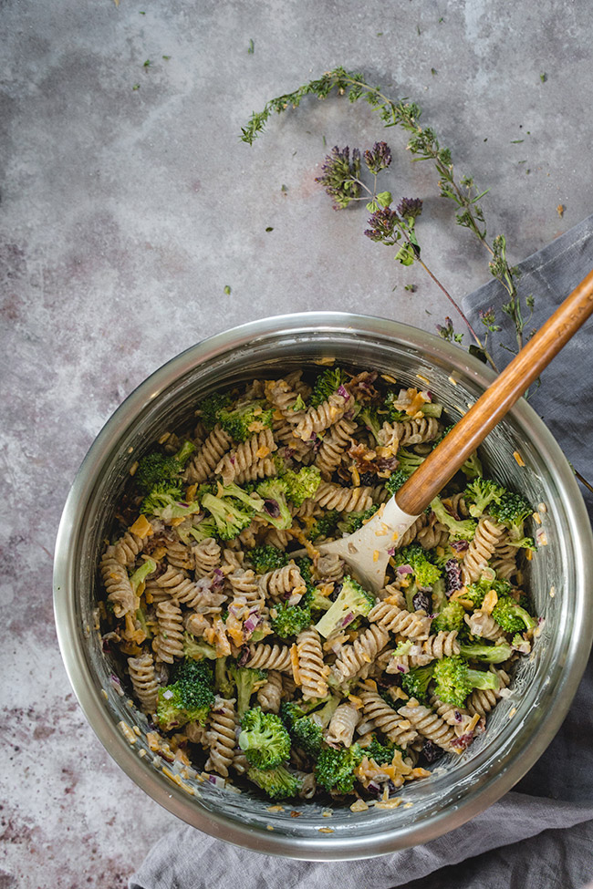 Mixing together the broccoli cheddar pasta salad ingredients