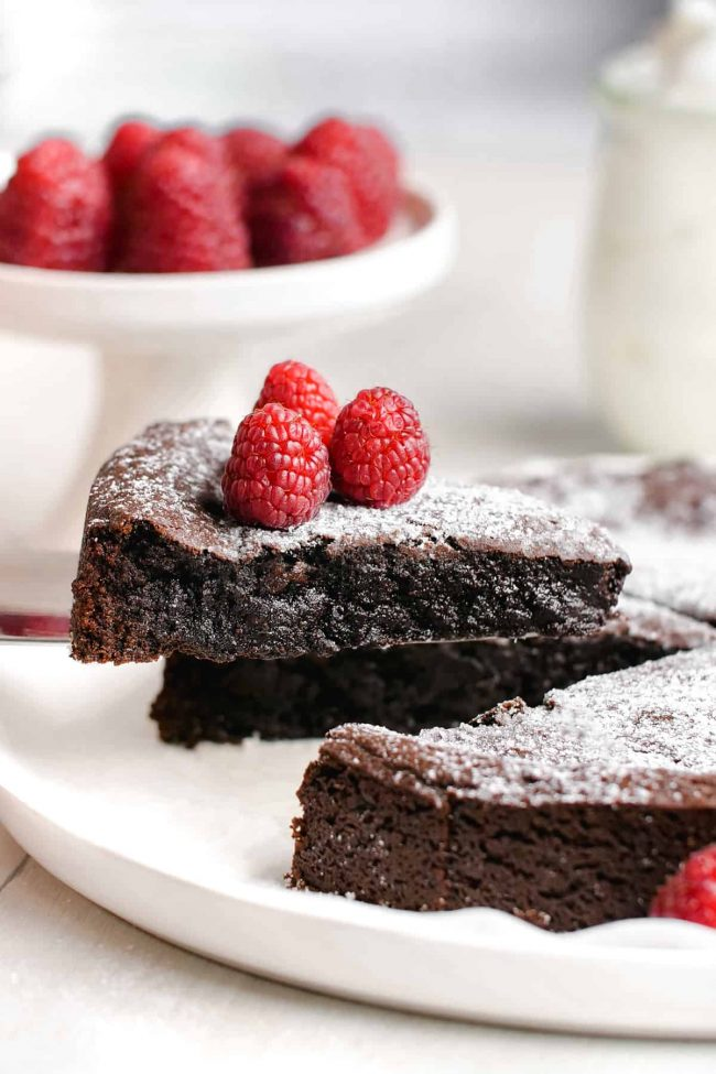 Swedish chocolate sticky cake slice with raspberries on top