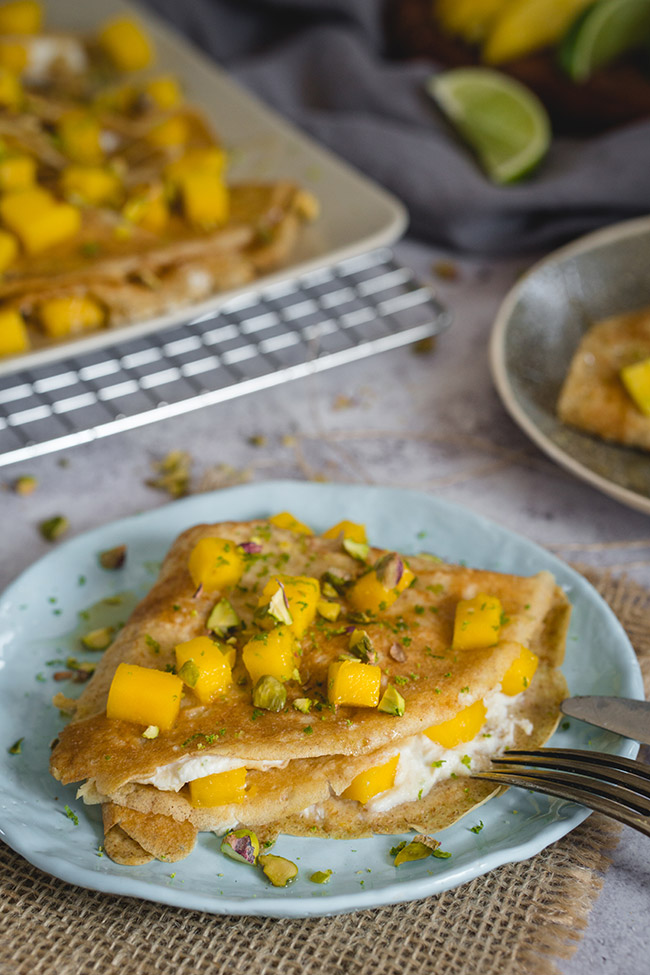 Mango crepes on a plate