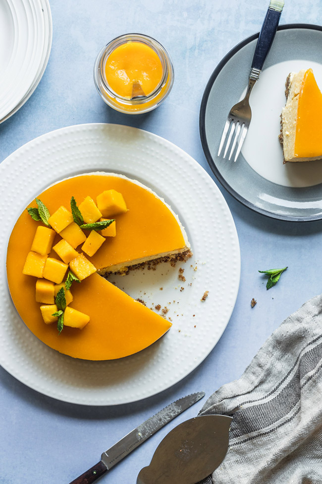 No-bake mango mousse cake topped with fresh cubed mango