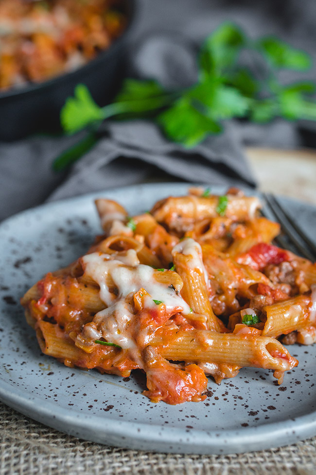 Plate of cheesy pasta bolognese