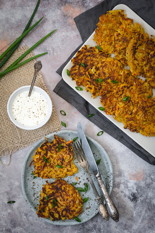 Tray and plate of pumpkin latkes