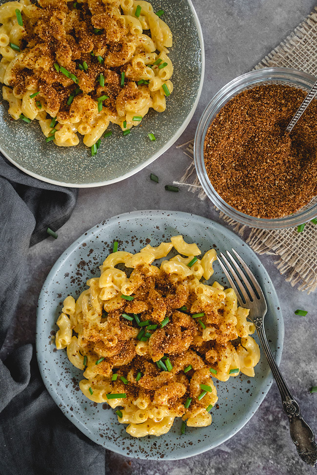 Plates of mac and cheese with kimchi topping
