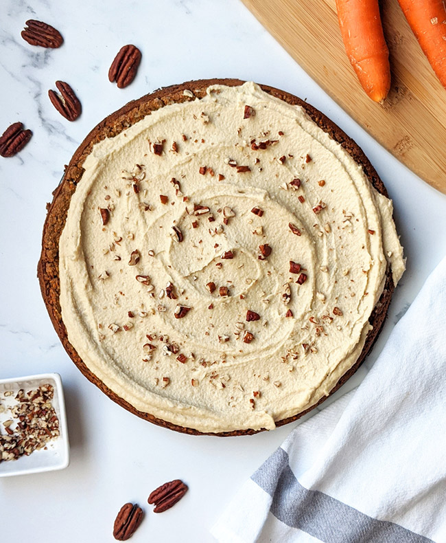 Vegan carrot cake with cashew cream frosting overhead shot