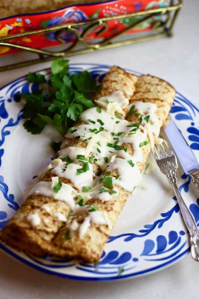 Crepes with chicken and mushrooms